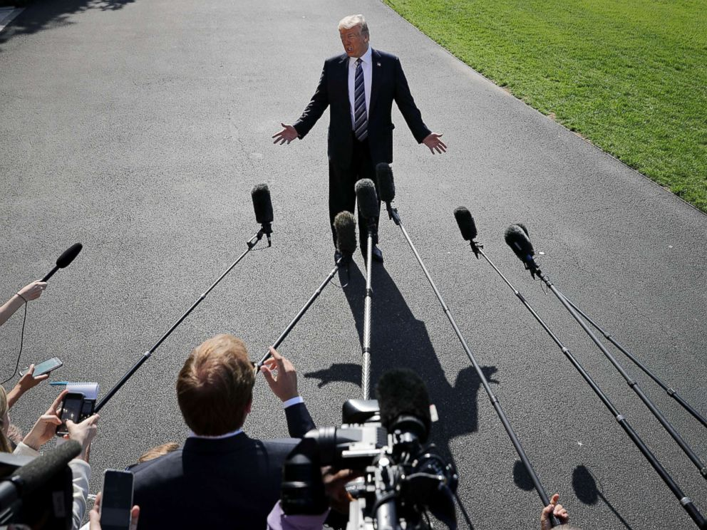 PHOTO: President Donald Trump talks to members of the news media before departing the White House, May 25, 2018 in Washington, D.C.
