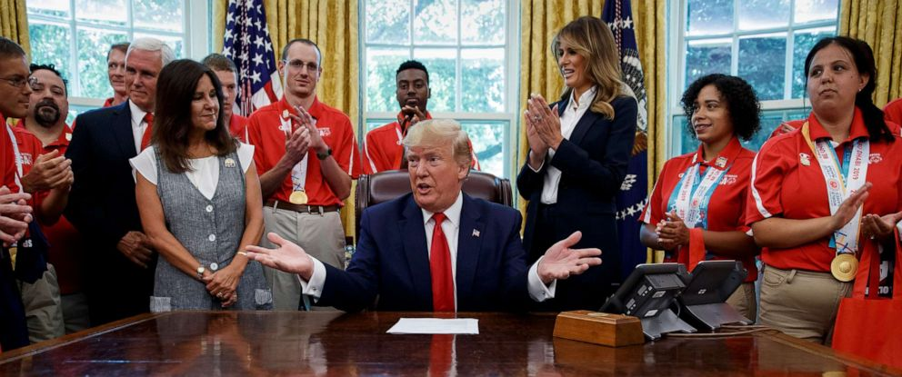 PHOTO: President Donald Trump, accompanied by Vice President Mike Pence, Karen Pence, and first lady Melania Trump, speaks during a photo opportunity with Special Olympics athletes and staff, in the Oval Office, July 18, 2019.