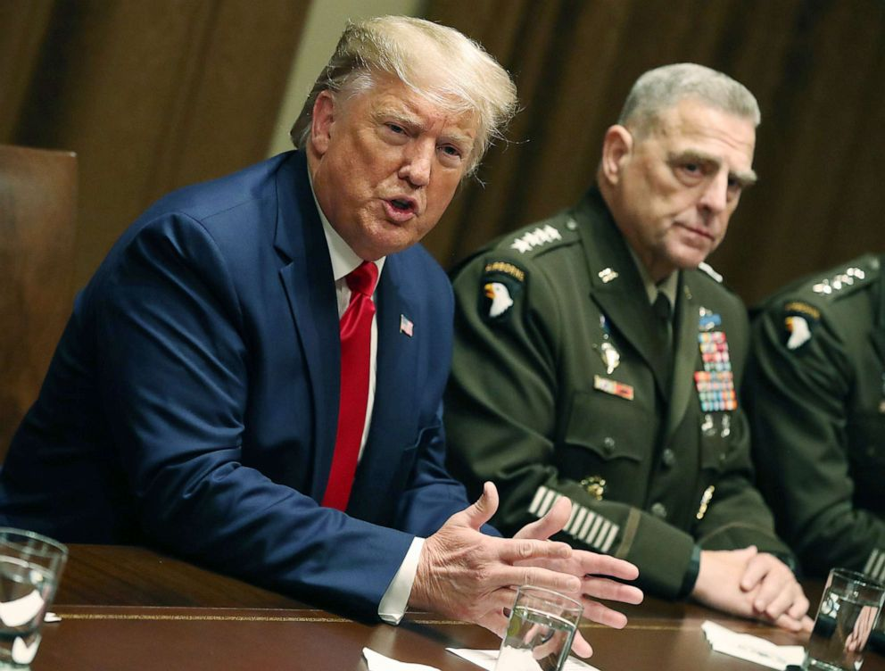 PHOTO: President Donald Trump speaks as Joint Chiefs of Staff Chairman, Army General Mark Milley looks on after a briefing from senior military leaders in the Cabinet Room at the White House on Oct. 7, 2019 in Washington, D.C.