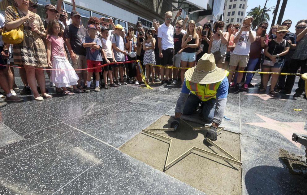 PHOTO: Workers repair the Donald Trumps star on the Hollywood Walk of Fame in Los Angeles on July 25, 2018. Trumps star was destroyed Wednesday morning by a man with a pick ax, the second time in less than two years the star was vandalized.