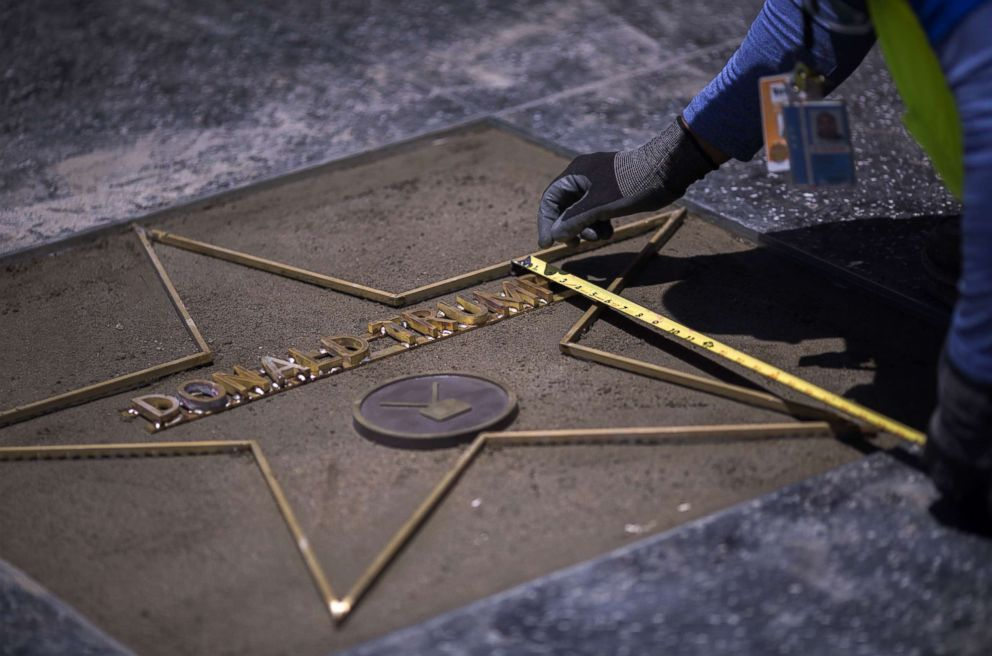 PHOTO: Workers replace the Star of President Donald Trump on the Hollywood Walk of Fame after it was destroyed by a vandal in the early morning hours on July 25, 2018 in Los Angeles, California.
