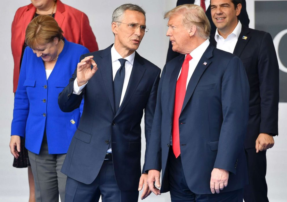 PHOTO: German Chancellor Angela Merkel, NATO Secretary-General Jens Stoltenberg and President Donald Trump attend a family photo during a summit of heads of state and government at NATO headquarters in Brussels on July 11, 2018.