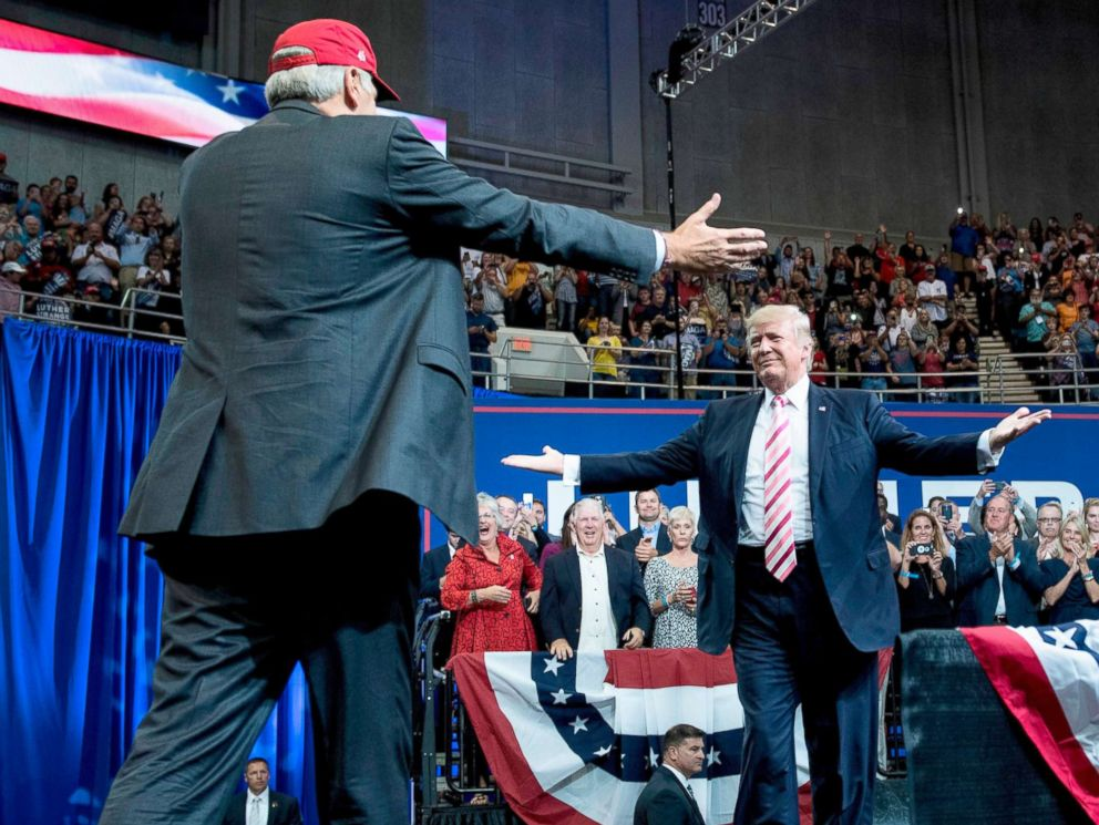 PHOTO: Alabama state Republican Senator Luther Strange, left, walks to embrace President Donald Trump during the senators rally at the Von Braun Civic Center September 22, 2017 in Huntsville, Ala.