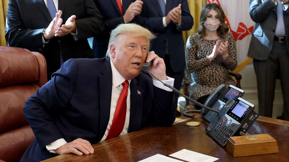 PHOTO: President Donald Trump speaks with Israeli Prime Minister Benjamin Netanyau on the phone about a Sudan-Israel peace agreement, in the Oval Office on Oct. 23, 2020, in Washington.