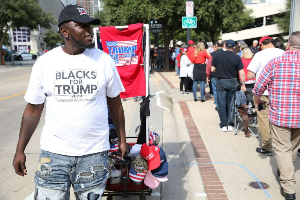 PHOTO: A vendor wears a campaign t-shirt that reads Blacks For Trump outside a rally with U.S. President Donald Trump in Dallas, Texas, U.S., on Thursday, Oct. 17, 2019.
