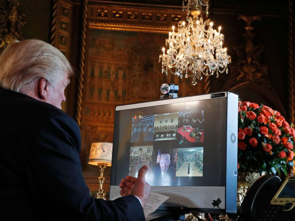 PHOTO: President Donald Trump speaks with members of the armed forces via video conference at his private club, Mar-a-Lago, on Thanksgiving, Nov. 23, 2017, in Palm Beach, Fla.