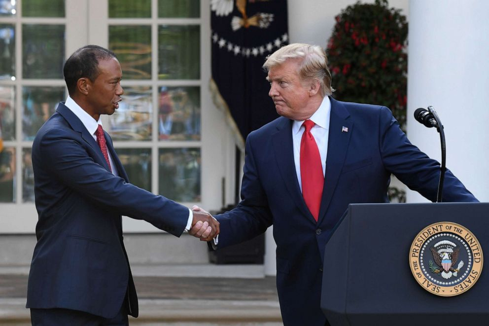 PHOTO: President Donald Trump shakes hands with golfer Tiger Woods during an event to present him with the Presidential Medal of Freedom in the Rose Garden of the White House in Washington, May 6, 2019.
