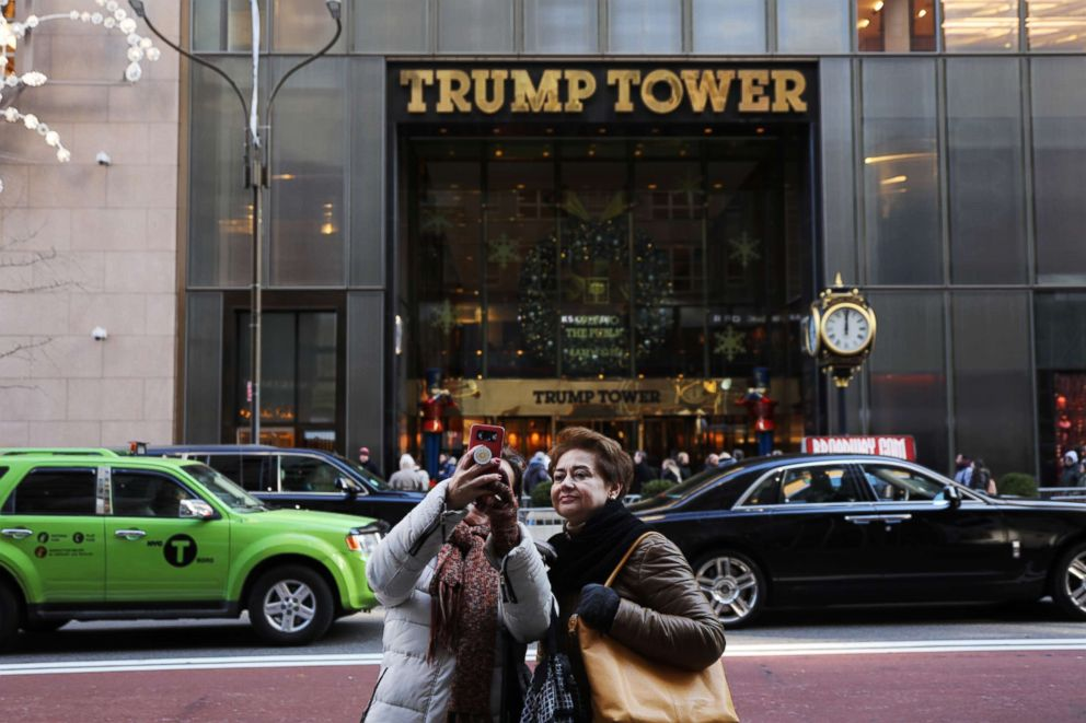 People walk by Trump Tower in midtown Manhattan on Dec. 10, 2018 in New York.