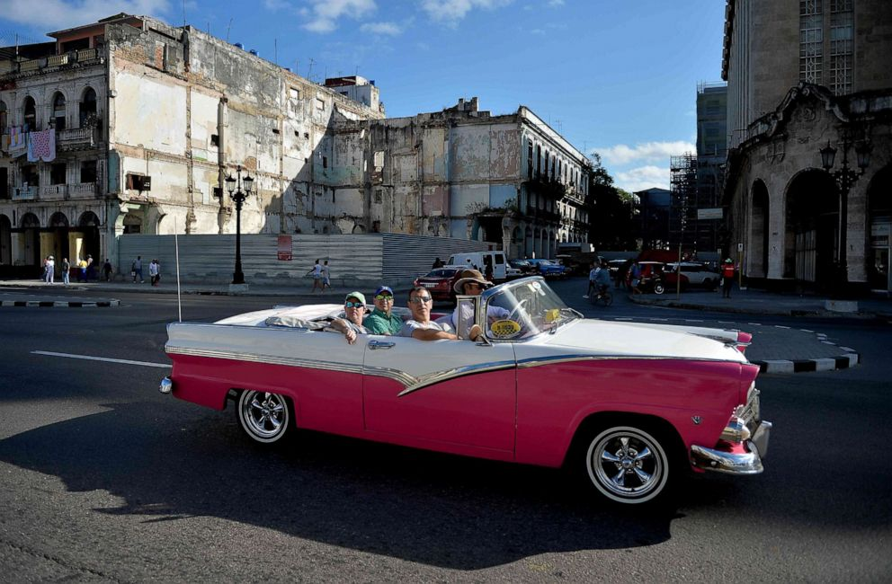 PHOTO: Tourists ride on an old American car serving as a taxi in Havana, Cuba, on May 6, 2019.