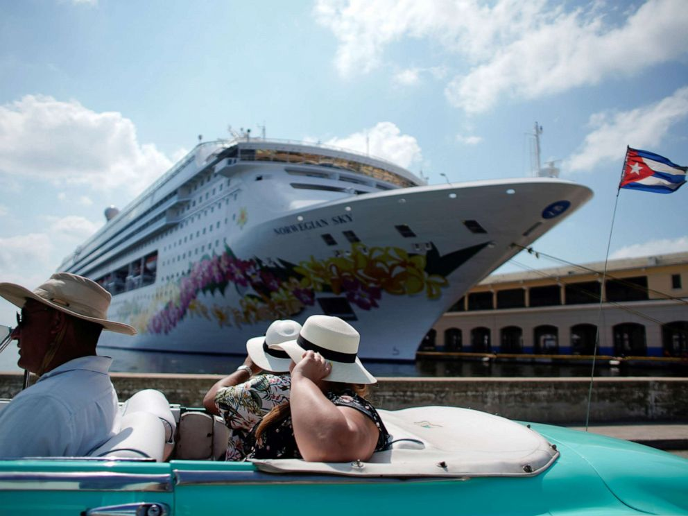 PHOTO: Tourists ride inside a vintage car as they pass by the Norwegian Sky cruise ship in Havana, Cuba, May 7, 2019.