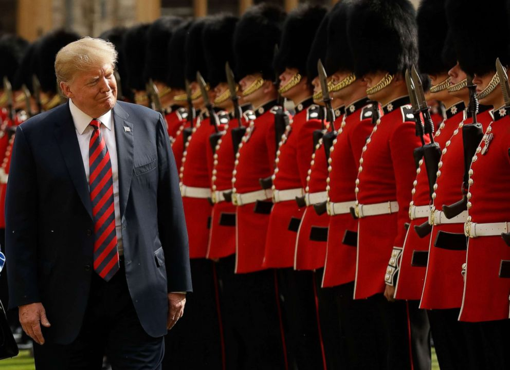 PHOTO: President Donald Trump inspects the guard of honour formed of the Coldstream Guards during a welcome ceremony at Windsor Castle on July 13, 2018 with Britains Queen Elizabeth II on the second day of Trumps U.K. visit.