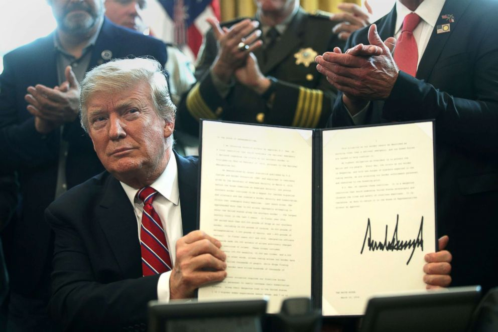 PHOTO: President Donald Trump holds an executive veto, his first as president, in the Oval Office, March 15, 2019. President Trump vetoed the congressional resolution that blocks his national emergency declaration on the southern border.