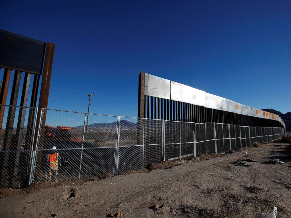 PHOTO: A worker stands next to a newly built section of the U.S.-Mexico border fence at Sunland Park, U.S. opposite the Mexican border city of Ciudad Juarez, Mexico, Jan. 25, 2017.