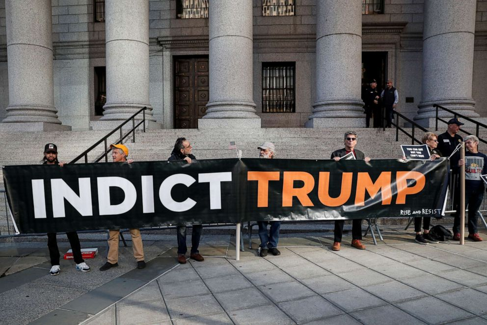PHOTO: Protesters hold a sign outside the United States Courthouse in the Manhattan borough of New York, Oct. 23, 2019.