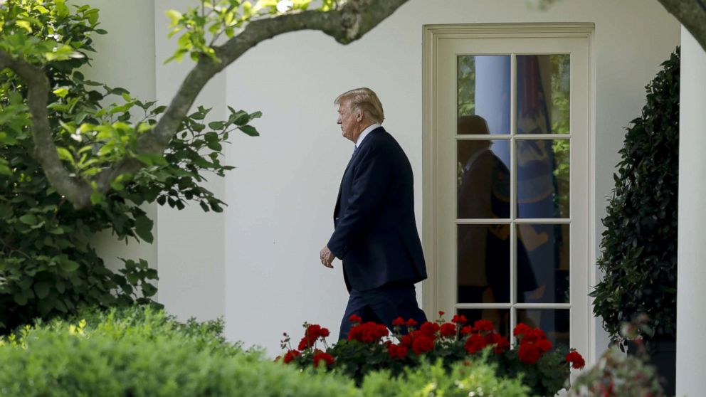 Donald Trump walks out of the Oval Office of the White House before boarding Marine One in Washington, May 14, 2018.