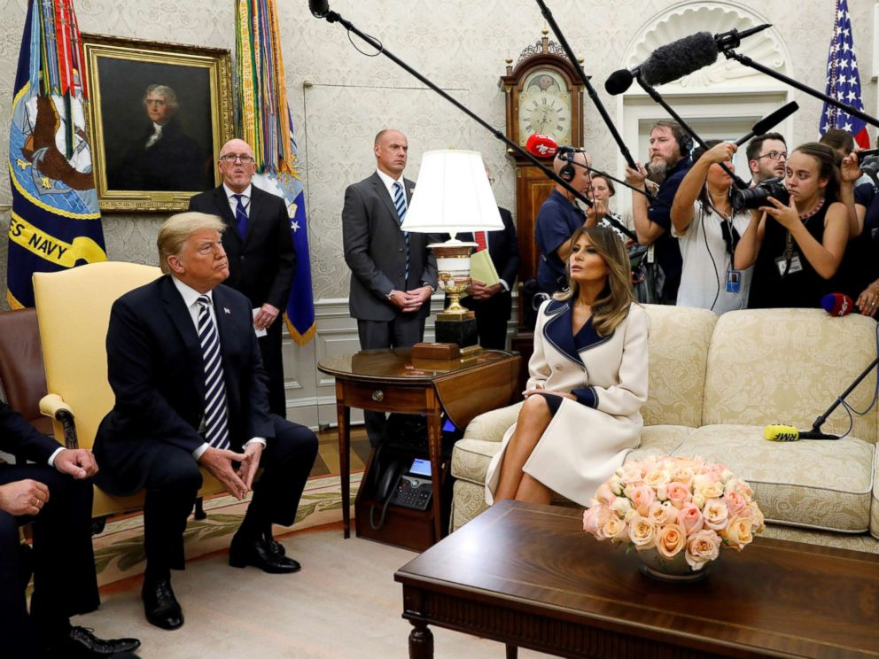 PHOTO: President Donald Trump listens to questions as he sits with first lady Melania Trump during a meeting with Polands President Andrzej Duda in the Oval Office, Sept. 18, 2018.