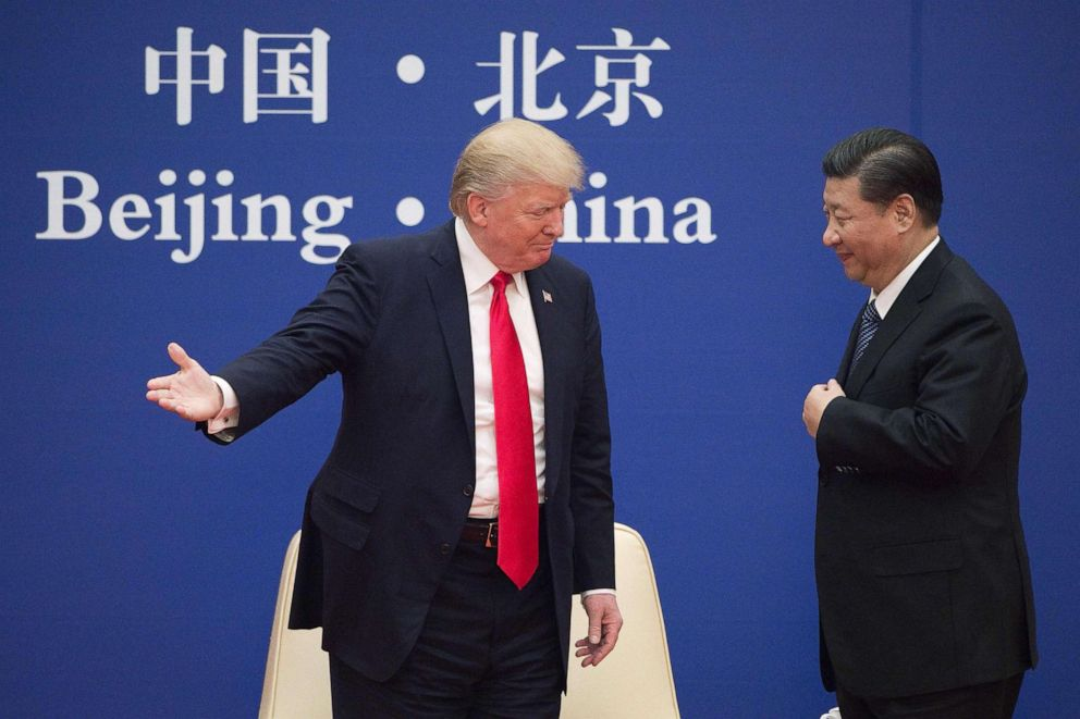 PHOTO: President Donald Trump gestures next to Chinas President Xi Jinping during a business leaders event at the Great Hall of the People in Beijing, Nov. 9, 2017.