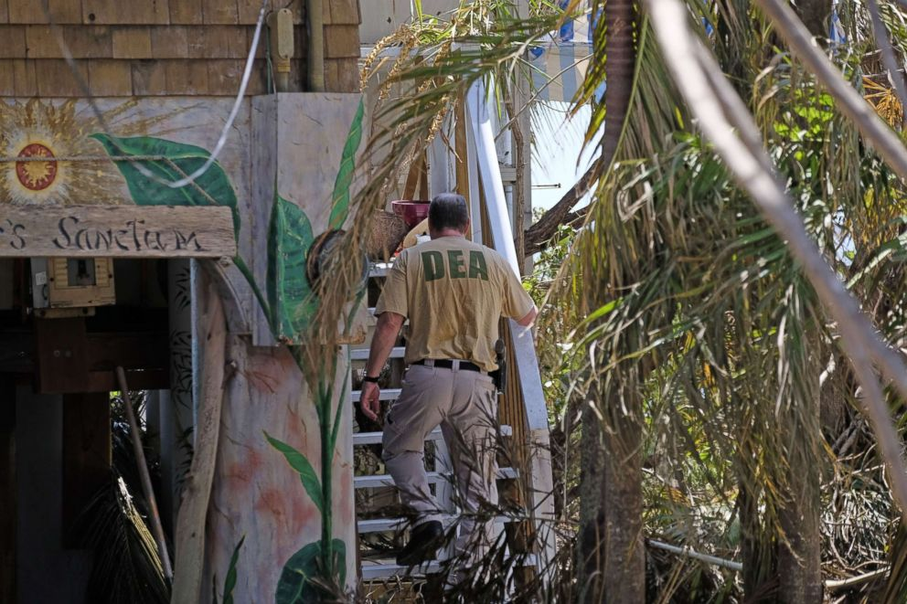 PHOTO: A DEA special agent checks a house for stranded victims on Cudjoe Key, Fla., Sept. 13, 2017, after Hurricane Irma passed through the area. The Florida Keys still lacks water, electricity or mobile phone service.