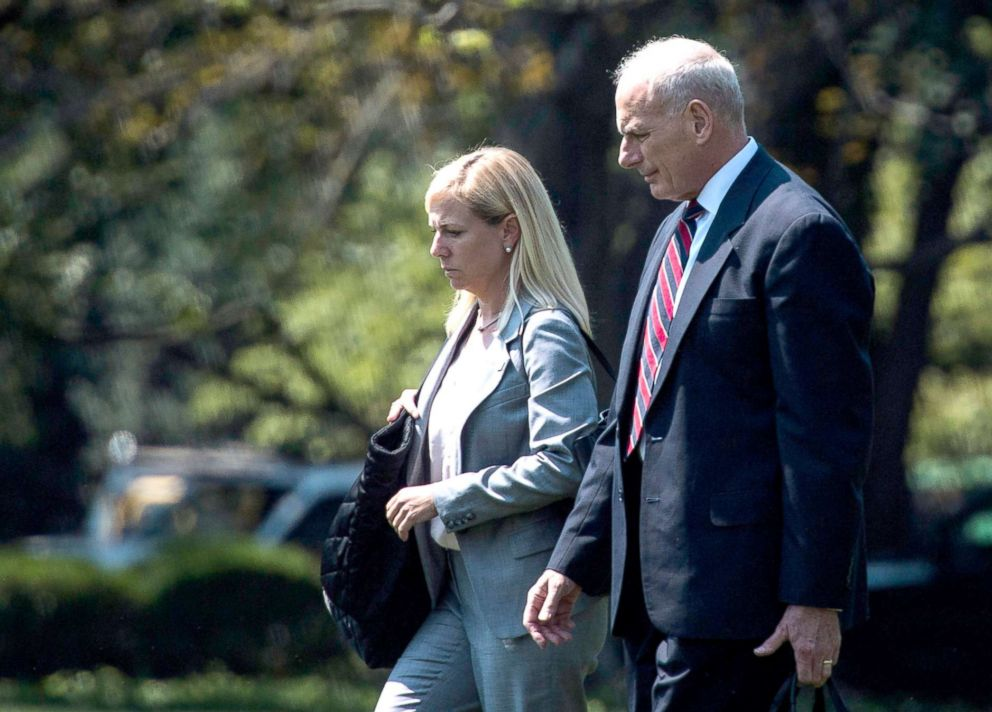 PHOTO: DHS Secretary Kirstjen Nielsen walks with White House chief of staff John Kelly across the South Lawn to board Marine One for a trip with President Donald Trump to Yuma, Ariz. to visit the U.S. border with Mexico, Aug 22, 2017.