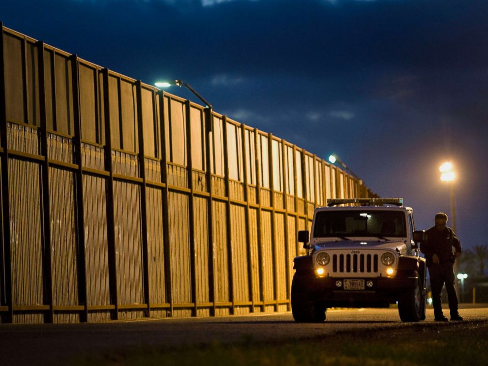 PHOTO: A U.S. Border Patrol agents stands outside his vehicle next to the U.S.-Mexico border fence in San Diego, Calif.,Feb. 26, 2015.