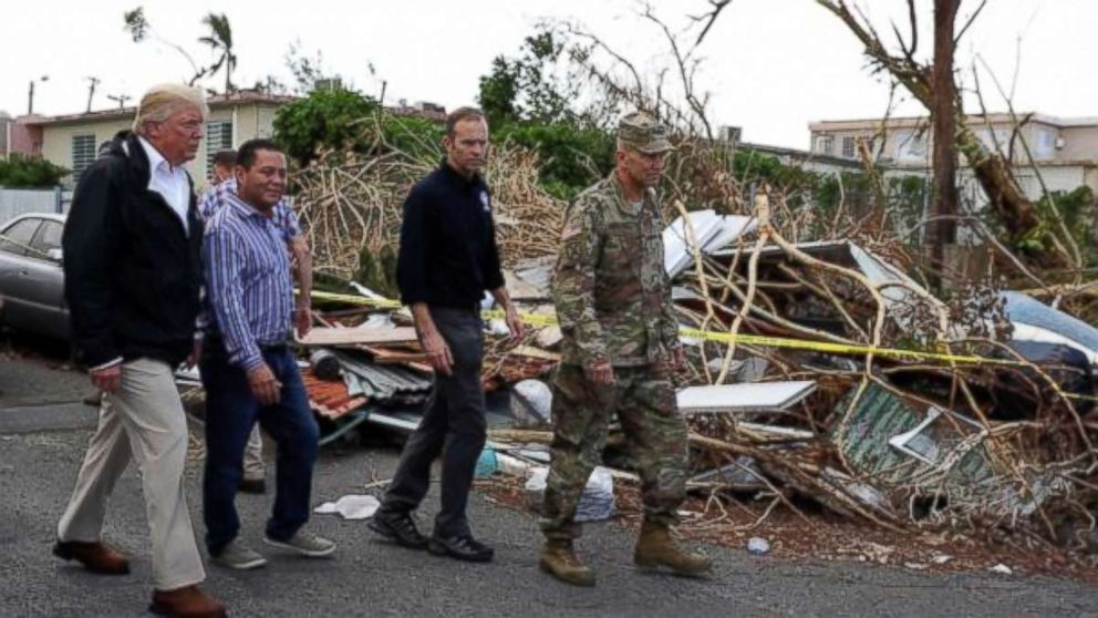 FEMA administrator Brock Long, second from right, with President Donald Trump and Lt. Gen. Jeff Buchanan, right as they toured an area affected by Hurricane Maria in Guaynabo, Puerto Rico, Oct. 3, 2017.