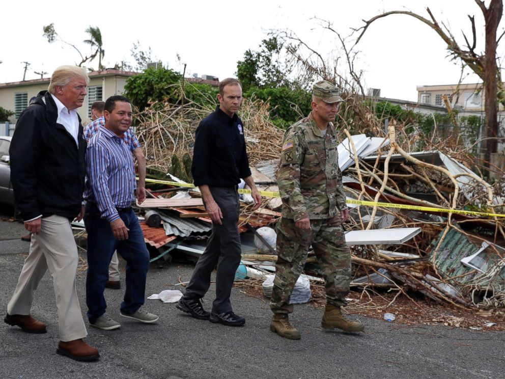PHOTO: FEMA administrator Brock Long, second from right, with President Donald Trump and Lt. Gen. Jeff Buchanan, right as they toured an area affected by Hurricane Maria in Guaynabo, Puerto Rico, Oct. 3, 2017.