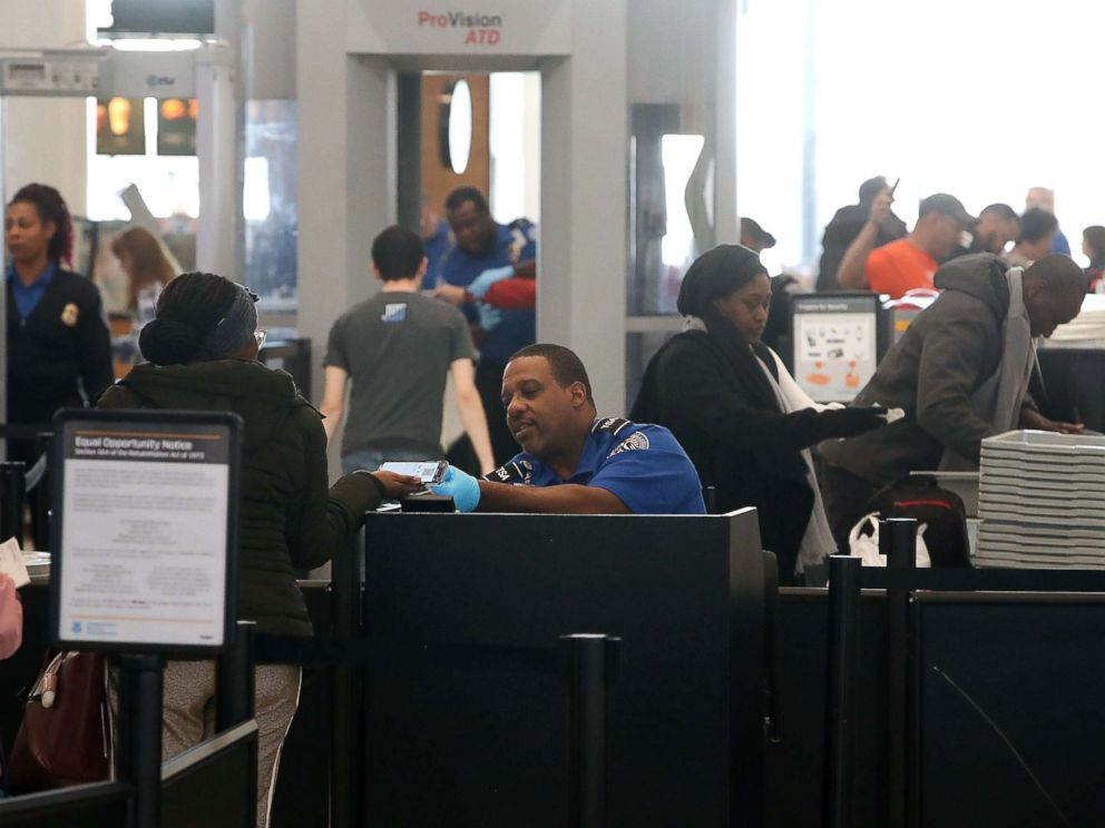 PHOTO: TSA employees, who are currently working without pay, screen passengers during the partial shutdown of the U.S. government, at Baltimore Washington International Thurgood Marshall Airport, on Jan. 14, 2019 in Baltimore.