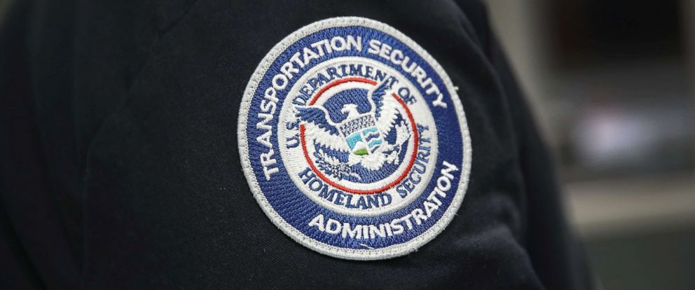 PHOTO: A Transportation Security Administration official works at the automated screening lanes at Miami International Airport, Oct. 24, 2017, in Miami.