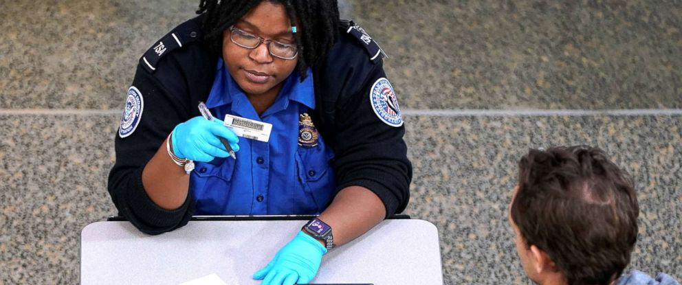 PHOTO: An employee with the Transportation Security Administration checks the documents of a traveler at Reagan National Airport in Washington D.C., Jan. 6, 2019.