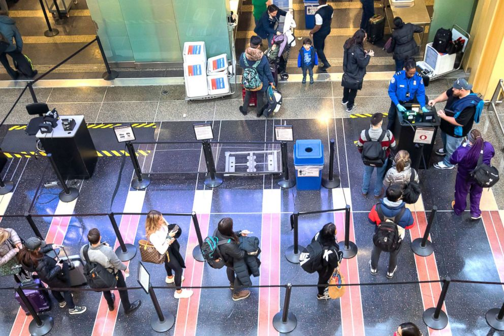 PHOTO: A Transportation Security Agency agent checks the identification of travelers at Ronald Reagan Washington National Airport in Arlington, Va., Jan. 7, 2019.