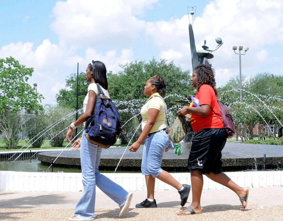 PHOTO: Students walk past the fountain at the Martin Luther King humanities building on the campus of Texas Southern University, July 9, 2008, in Houston.