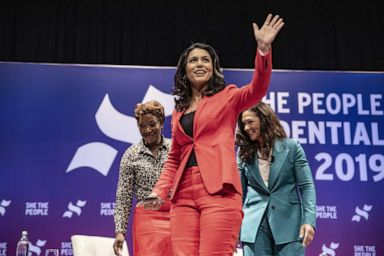 PHOTO: Democratic presidential candidate Rep. Tulsi Gabbard (D-HI) waves to a crowd at the She The People Presidential Forum, April 24, 2019, in Houston, Texas.