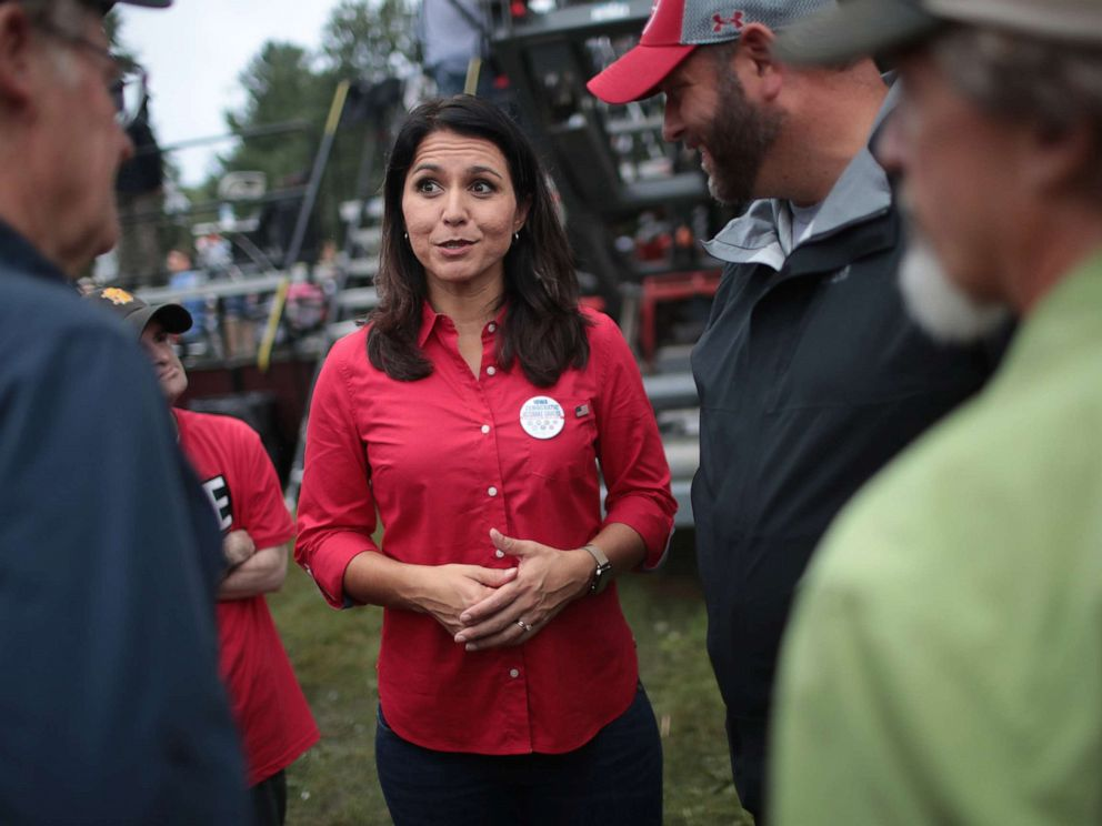 PHOTO: Democratic presidential candidate and Hawaii congresswoman Tulsi Gabbard greets guests at the Polk County Democrats Steak Fry, Sept. 21, 2019, in Des Moines, Iowa.