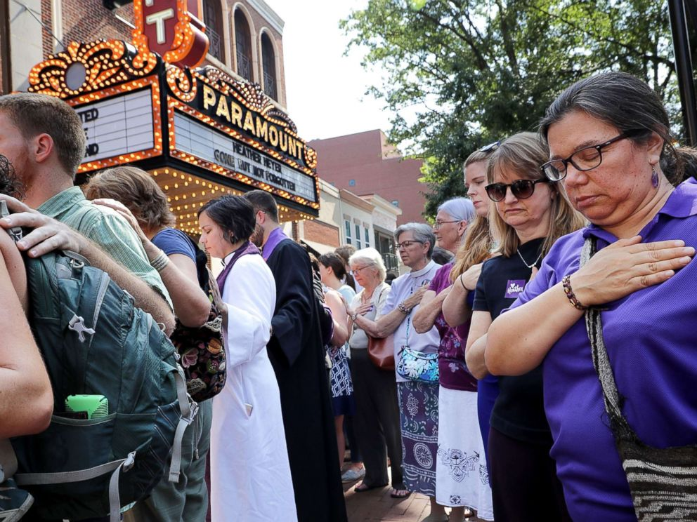 PHOTO: Clergy observe a moment of silence during the memorial service for Heather Heyer outside the Paramount Theater, Aug. 16, 2017 in Charlottesville, Va.