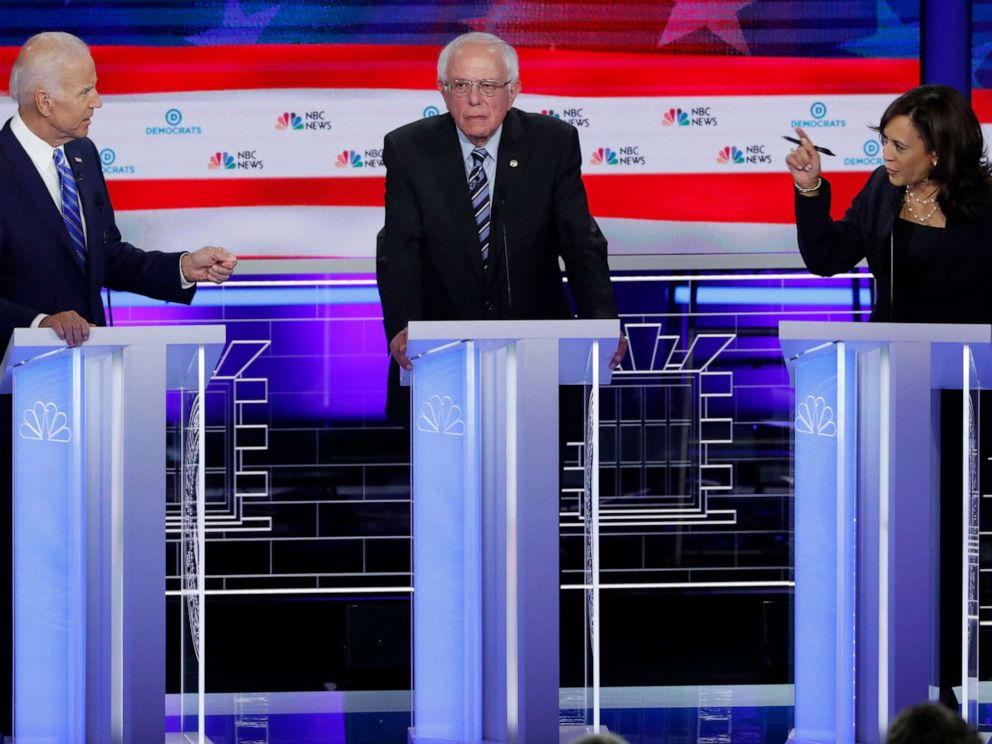 PHOTO: Former Vice President Joe Biden defends his record on race issues against Sen. Kamala Harris as Sen. Bernie Sanders listens during the second night of the first Democratic presidential 2020 election debate in Miami, June 27, 2019.