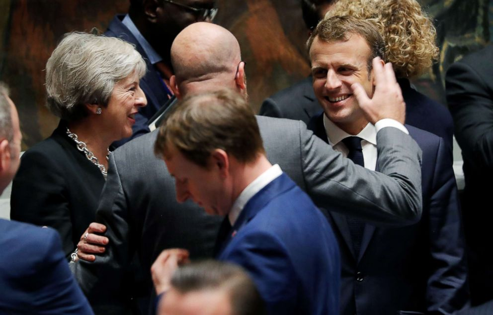 PHOTO: Britains Prime Minister Teresa May, left, and Belgiums Prime Minister Charles Michel, center, greet Frances President Emmanuel Macron, right, at the start of the United Nations Security Council meeting in New York, Sept. 26, 2018.