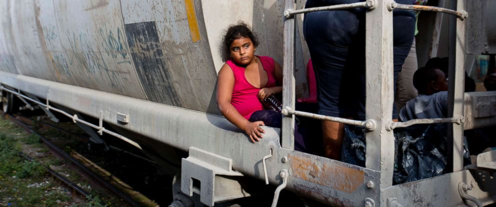 PHOTO: A young migrant girl waits for a freight train to depart on her way to the U.S. border, in Ixtepec, Mexico. The number of unaccompanied minors detained on the U.S. border has more than tripled since 2011.