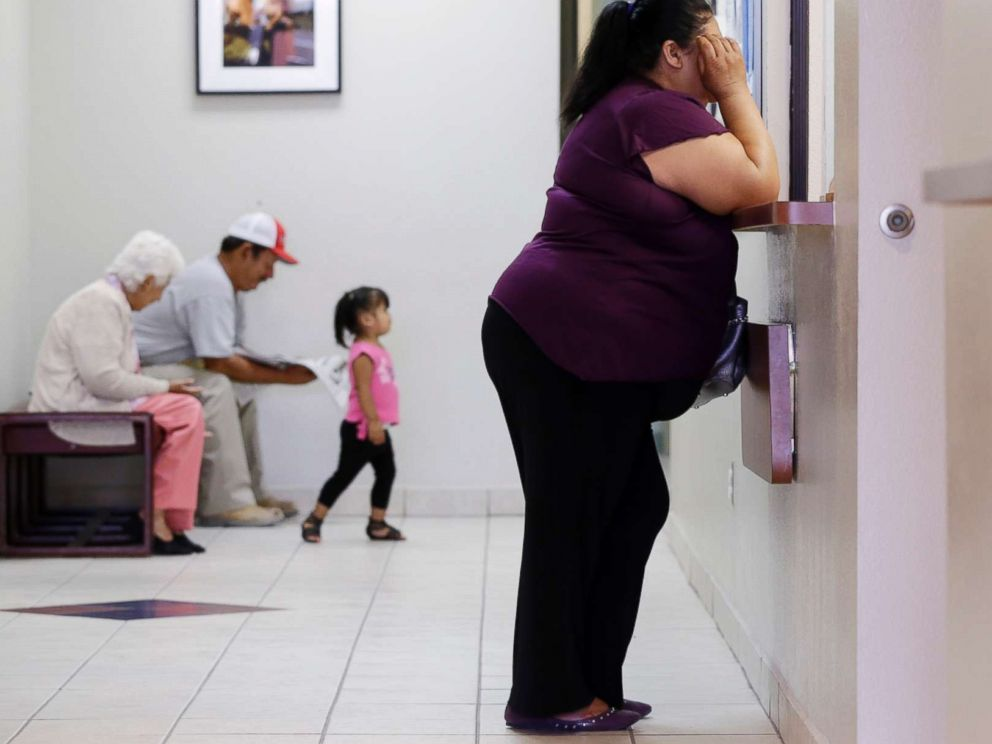 PHOTO: In this July 12, 2012 photo, a woman stands at the registration window at Nuestra Clinica Del Valle in San Juan, Texas.