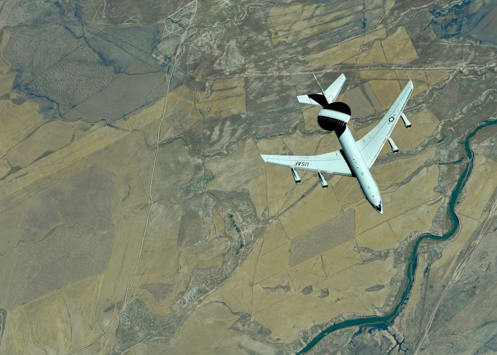 PHOTO: A U.S. Air Force E-3 Sentry (AWACS) descends after receiving fuel from a KC-10 Extender, assigned to the 908th Expeditionary Air Refueling Squadron, out of Al Dhafra Air Base, United Arab Emirates, Sept. 1, 2019.