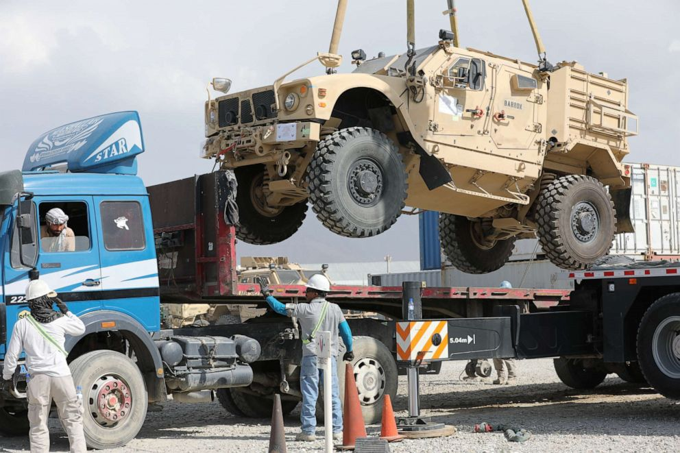 PHOTO: A U.S. military vehicle is loaded on a flatbed trailer on Bagram Air Field in Afghanistan, July 12, 2020.