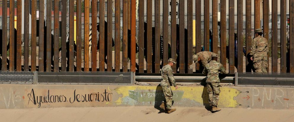 PHOTO: U.S. soldiers walk next to the border fence between Mexico and the United States in El Paso, Texas, April 3, 2019.