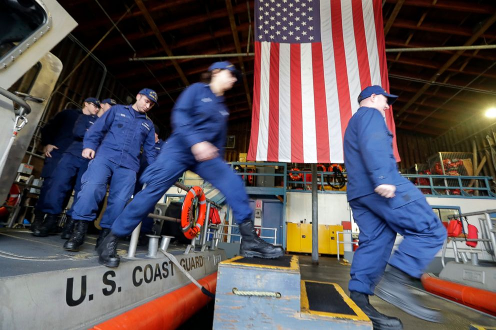 PHOTO: U.S. Coast Guardsmen and women walk off a 45-foot response boat during their shift at Sector Puget Sound base in Seattle, Jan. 16, 2019.