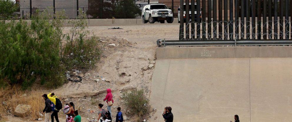 PHOTO: Migrants are seen after crossing illegally into El Paso, Texas, U.S., as seen from Paso del Norte border crossing bridge in Ciudad Juarez, Mexico, July 22, 2019.