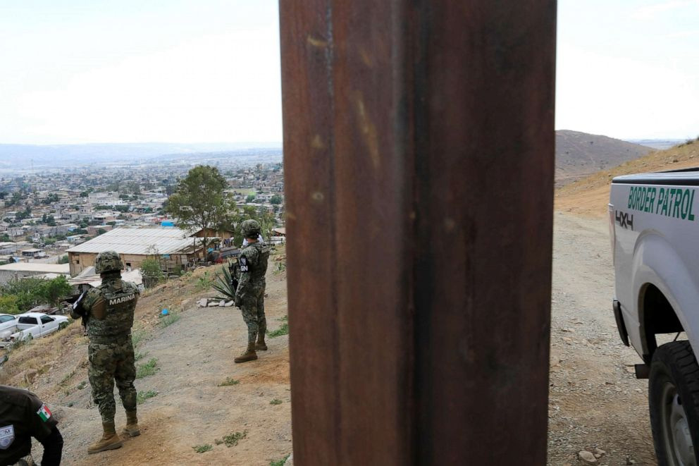 PHOTO: A U.S. Customs and Border Protection vehicle parks next to border fence between Mexico and U.S. as seen from Tijuana, Mexico, July 23, 2019.