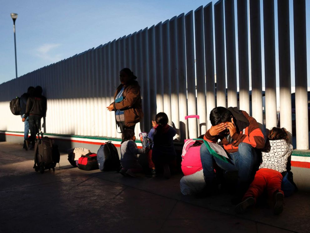 PHOTO: A migrant sits with his children as they wait to hear if their number is called to apply for asylum in the United States, Jan. 25, 2019, in Tijuana, Mexico.
