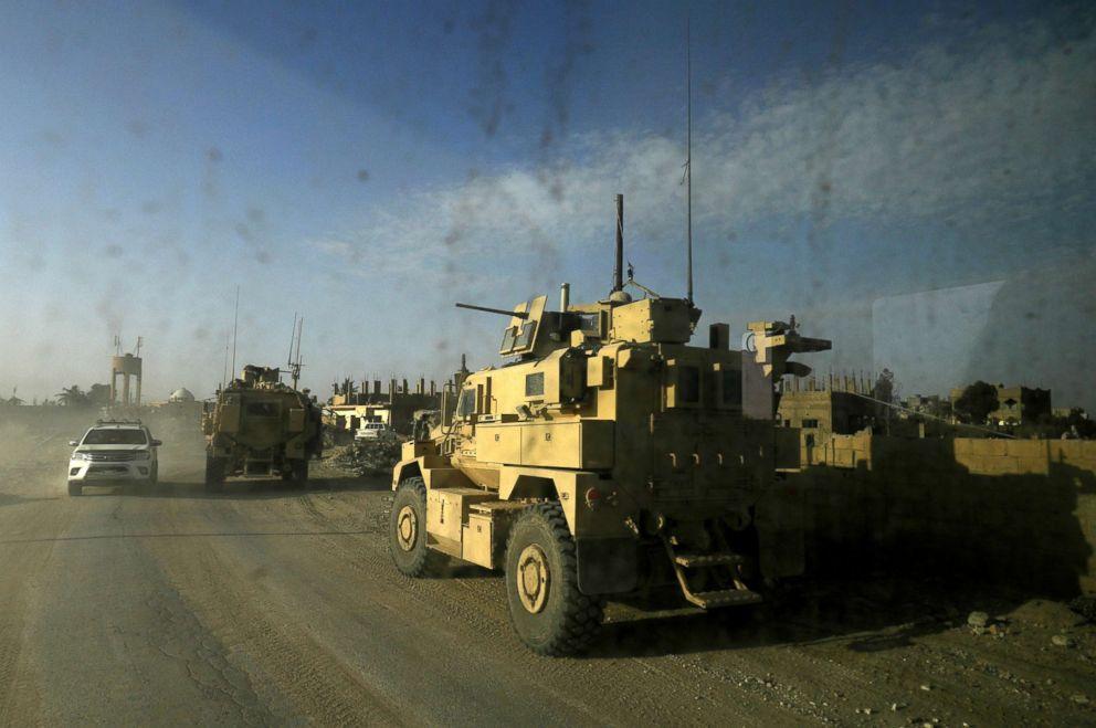 PHOTO: US military vehicles drive through the Baghuz, Syria, Jan. 26, 2019.