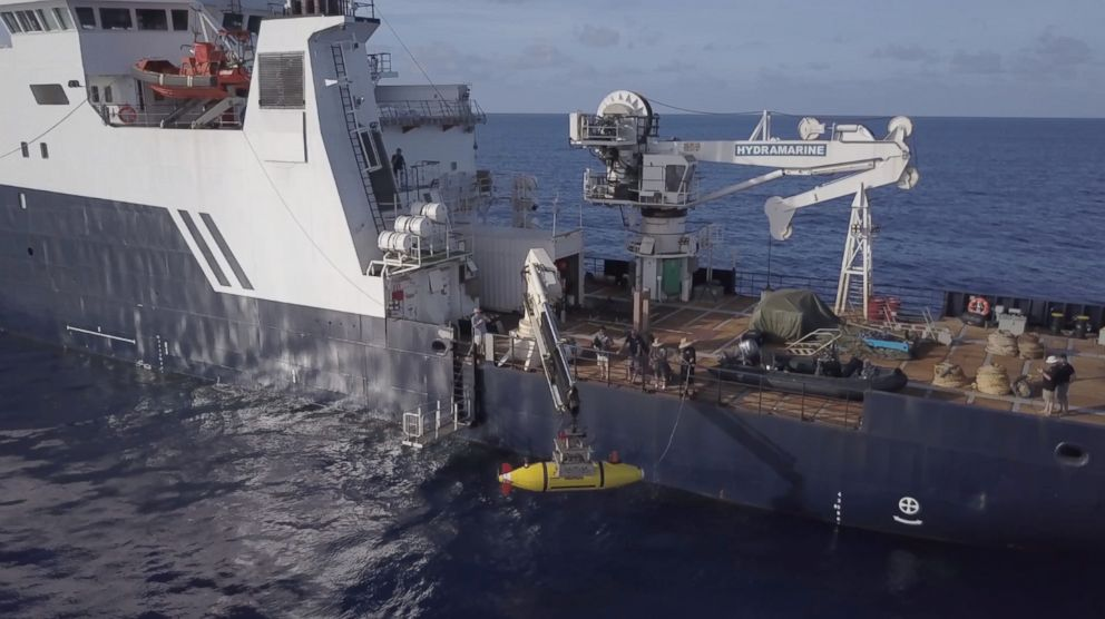 The AUV Hydroid Remus 6000 is deployed from the R/V Petrel. The autonomous underwater vehicle is capable of operations in up to 6,000 meters of water.