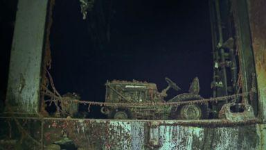 PHOTO: An international harvester aircraft tug sits on the sunken aircraft carrier USS Hornet.