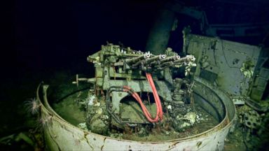 PHOTO: A 1.1 inch anti-aircraft gun sits on the remains of the USS Hornet.
