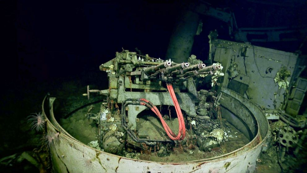 A 1.1 inch anti-aircraft gun sits on the remains of the USS Hornet.
